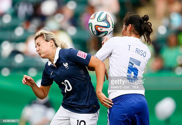 Claire Lavogez of France challenges Tania Riso of Paraguay for a header during the FIFA U20 Women's World Cup Canada 2014 Group D match between...