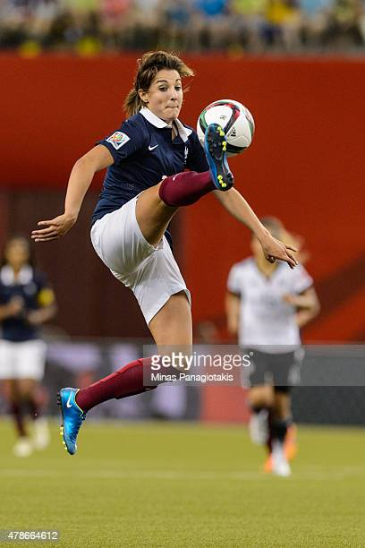 Claire Lavogez of France jumps for the ball during the 2015 FIFA Women's World Cup quarter final match against Germany at Olympic Stadium on June 26...
