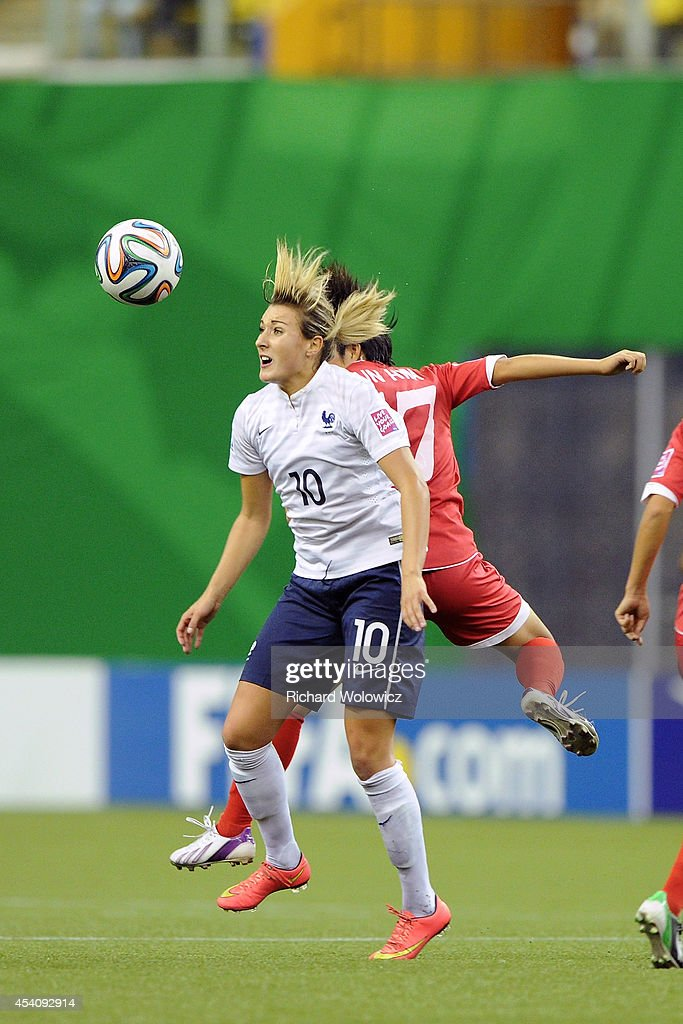 Claire Lavogez of France jumps to head the ball in front of Choe Un Hwa of Korea DPR during the FIFA Women's U-20 3rd place game at Olympic Stadium on August 24, 2014 in Montreal, Quebec, Canada. France defeated Korea DPR