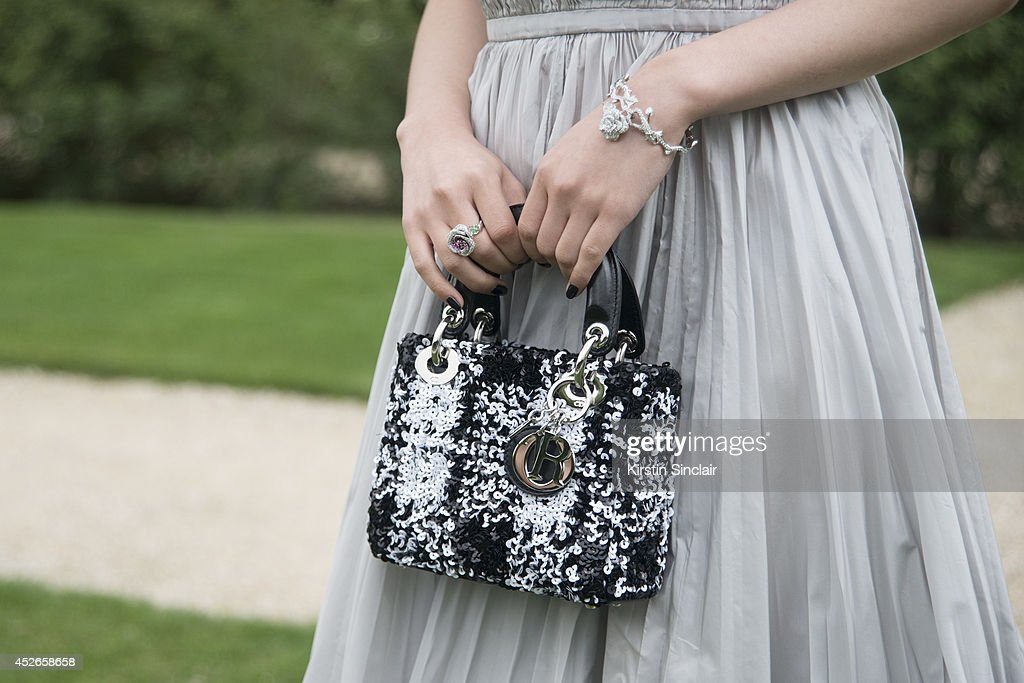 Claire Li Oi Man wears all Dior day 2 of Paris Haute Couture Fashion Week Autumn/Winter 2014 on July 7 2014 in Paris France