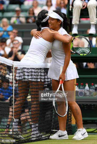 Claire Liu of the United States is embraced by runnerup Ann Li of the United States after the Girl's Singles final match on day twelve of the...