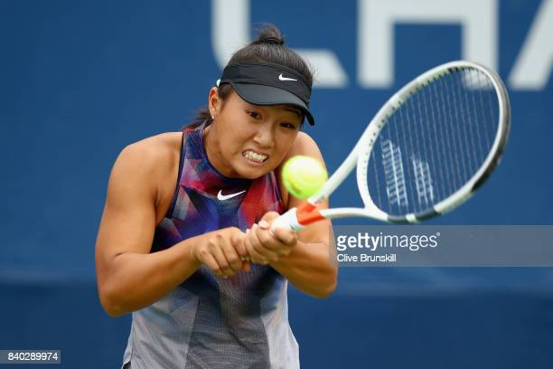 Claire Liu of the United States returns a shot during her first round Women's Singles match against YingYing Duan of China on Day One of the 2017 US...