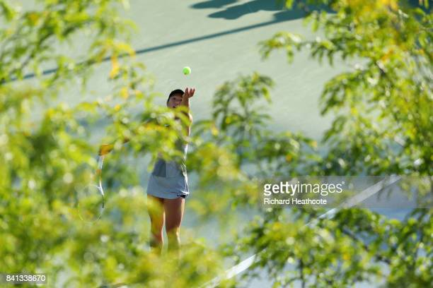 Claire Liu of the United States serves against Alla Kudryavtseva of Russia and Saisai Zheng of China during their first round Wom on Day Four of the...