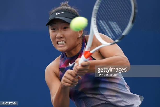 Claire Liu of the US returns the ball to YingYing Duan of China during their Women's Singles match at the 2017 US Open Tennis Tournament on August 28...
