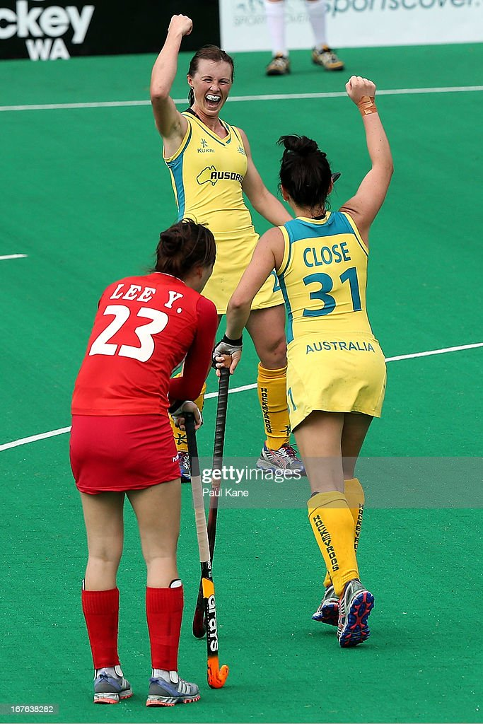 Claire Messent of Australia celebrates a goal with Jade Close during the International Test match between the Australian Hockeyroos and Korea at Perth Hockey Stadium on April 27, 2013 in Perth, Australia.