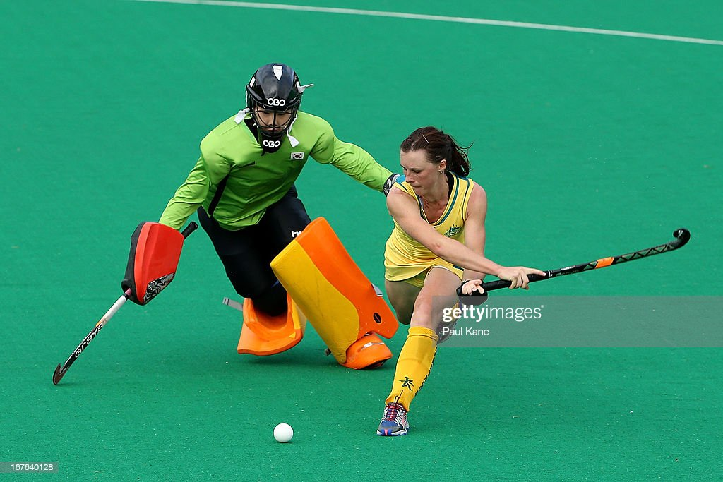 Claire Messent of Australia challenges Jung Hea Bin in a penalty shoot out practice after the International Test match between the Australian Hockeyroos and Korea at Perth Hockey Stadium on April 27, 2013 in Perth, Australia.