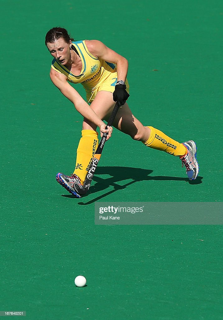 Claire Messent of Australia passes the ball during the International Test match between the Australian Hockeyroos and Korea at Perth Hockey Stadium on April 27, 2013 in Perth, Australia.