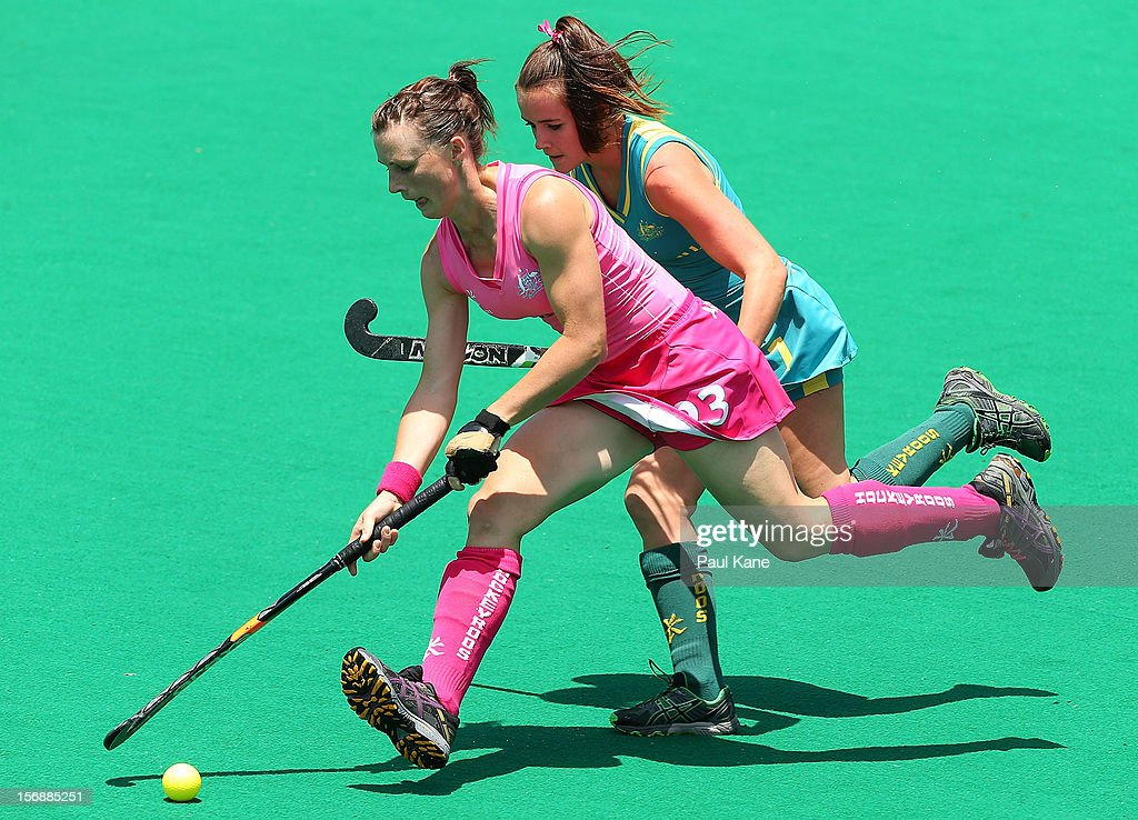 Claire Messent of the Hockeyroos controls the ball against Amelia Spence of the Jillaroos in the womens Australia Hockeyroos v Australia u21 Jillaroos game during day three of the 2012 International Super Series at Perth Hockey Stadium on November 24, 2012 in Perth, Australia.