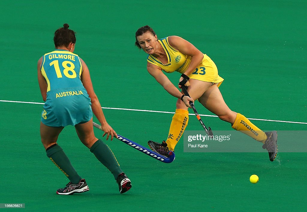 Claire Messent of the Hockeyroos passes the ball against Kate Gilmore of the Jillaroos during the womens Australia v Australia under 21 game on day one of the 2012 International Super Series at Perth Hockey Stadium on November 22, 2012 in Perth, Australia.