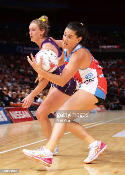 Claire O'Brien of the Swifts is challenged by Gabi Simpson of the Firebirds during the round 14 Super Netball match between the Swifts and the...