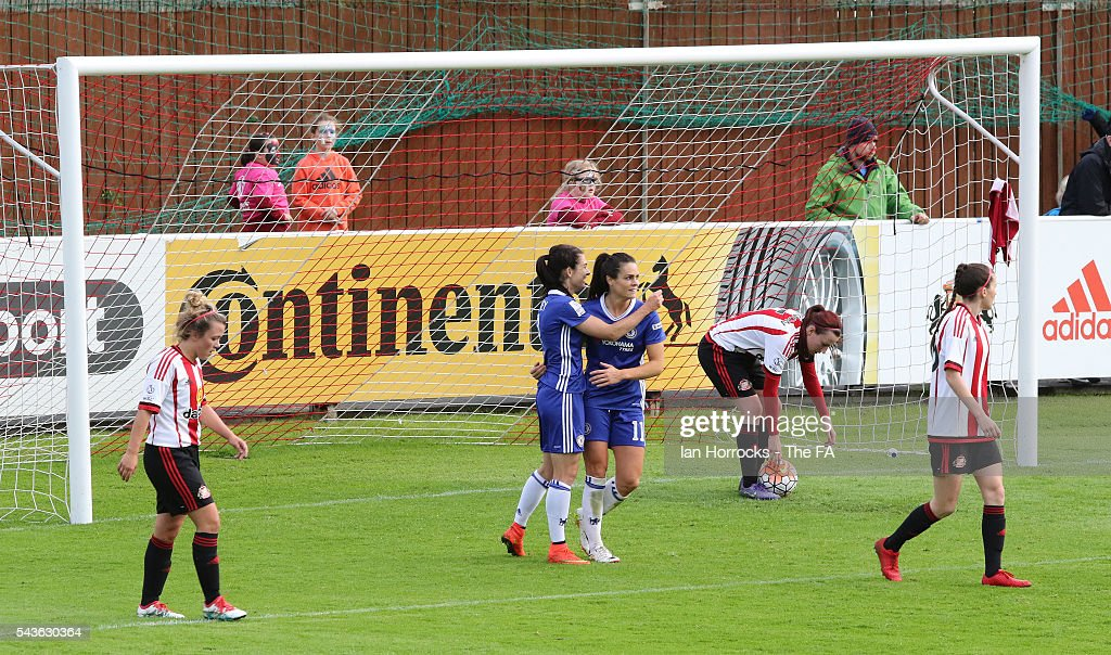 Claire Rafferty of Chelsea (C) celebrates with team-mate Karen Carney after scoring the second Chelsea goal during the WSL 1 League match between Sunderland Ladies and Chelsea Ladies FC at the Hetton Center on June 29, 2016 in Hetton, England.