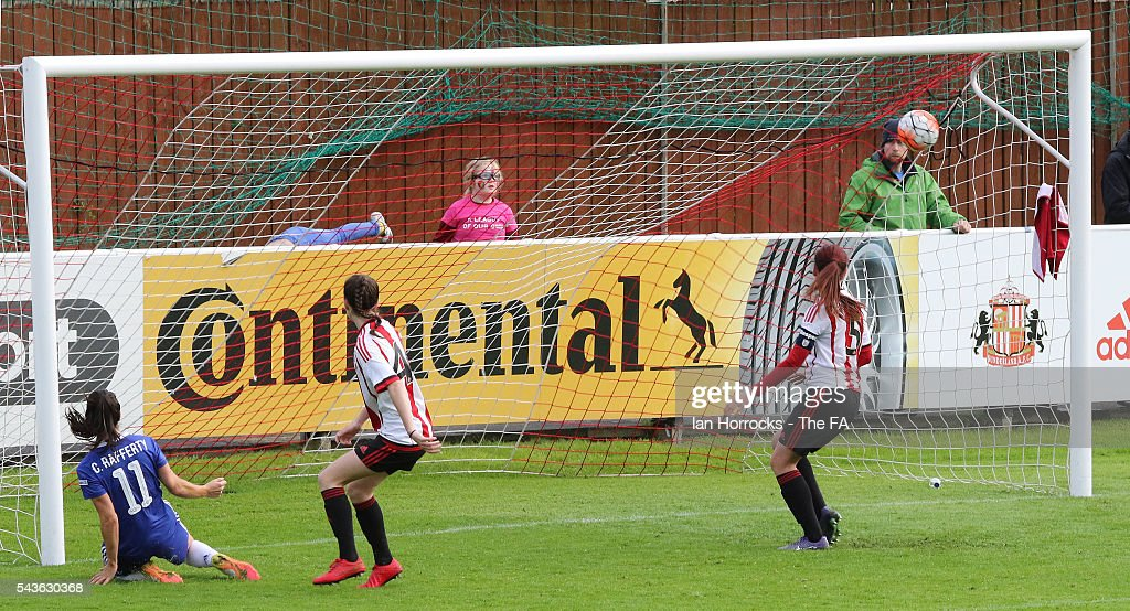 Claire Rafferty of Chelsea (L) scores the second Chelsea goal during the WSL 1 League match between Sunderland Ladies and Chelsea Ladies FC at the Hetton Center on June 29, 2016 in Hetton, England.