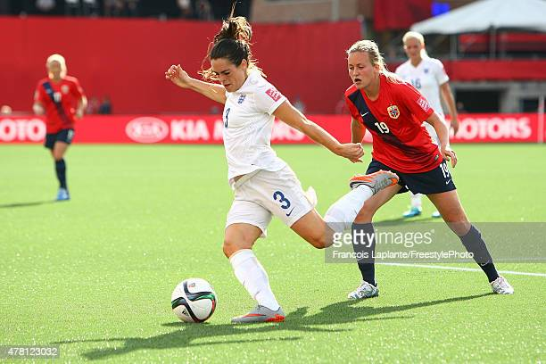 Claire Rafferty of England boots the ball against Kristine Minde of Norway during the FIFA Women's World Cup Canada 2015 round of 16 match between...
