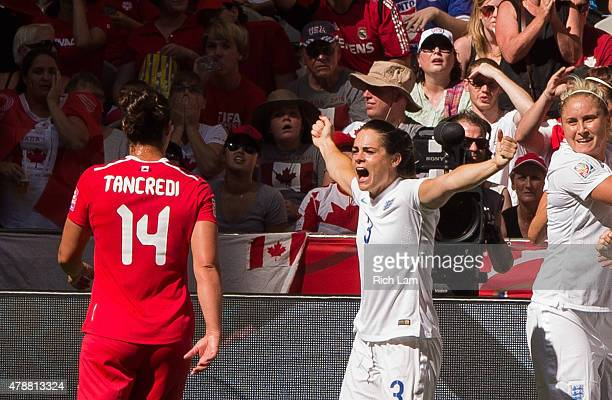 Claire Rafferty of England celebrates team mate Lucy Bronze's goal as Melissa Tancredi of Canada walks past during the FIFA Women's World Cup Canada...