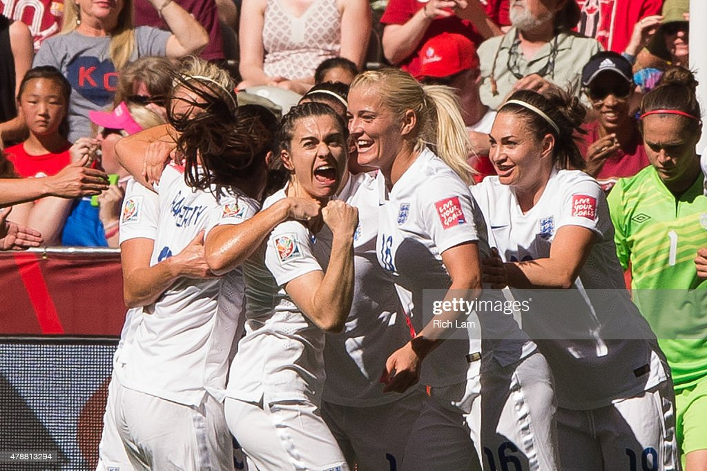 Claire Rafferty of England celebrates team mate Lucy Bronze's goal against Canada walks during the FIFA Women's World Cup Canada 2015 Quarter Final...