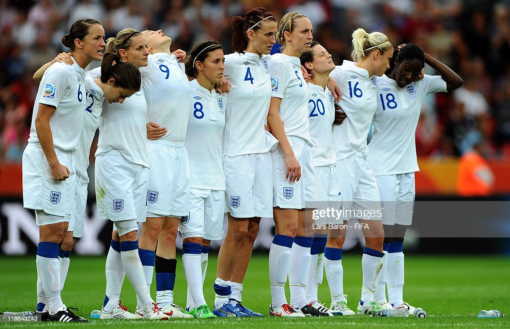 Claire Rafferty of England (#20), who missed the first penalty for England, looks dejected next to her team mates during the FIFA Women's World Cup 2011 Quarter Final match between England and France at the FIFA Women's World Cup Stadium Leverkusen on July 9, 2011 in Leverkusen, Germany.