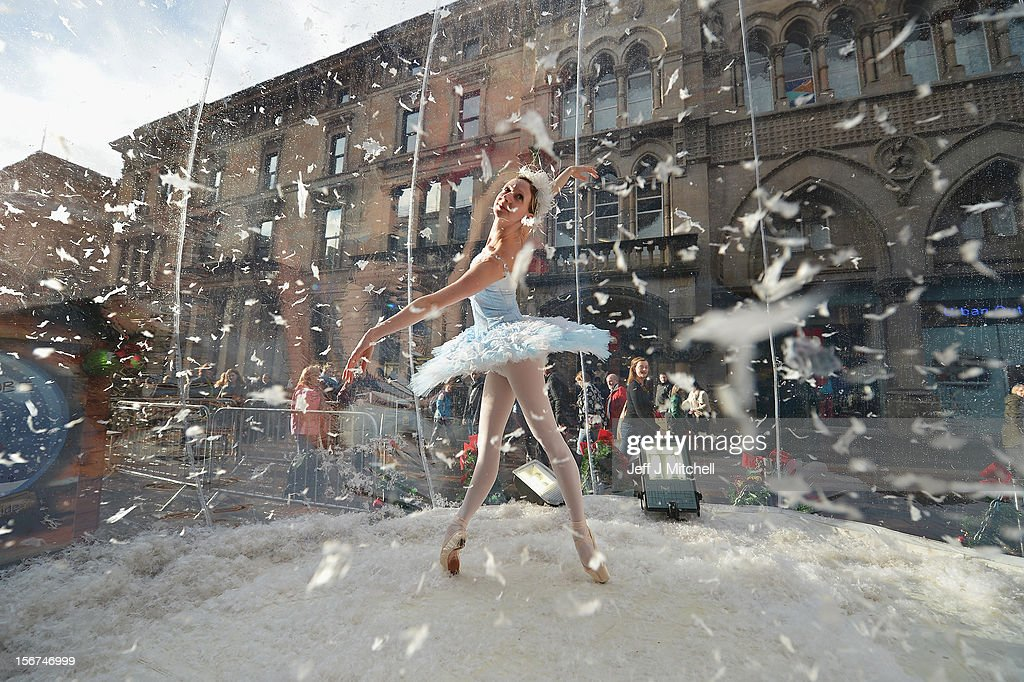 Claire Robertson from Scottish Ballet, poses dressed as the Good Snow Flake inside a life size snow globe on Buchanan Street during a promotion for Scottish Ballet's festive production of The Nutcracker on November 20, 2012 in Glasgow,Scotland. The Nutcracker opens at the Theatre Royal on December the 8th, the production delves deep into the darker reaches of Hoffmann's original tale in a fresh and vivid retelling of the famous Christmas story.
