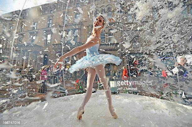 Claire Robertson from Scottish Ballet poses dressed as the Good Snow Flake inside a life size snow globe on Buchanan Street during a promotion for...