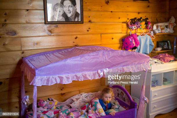 Claire Smith in her bed before a nap She sleeps in her mother's old room and a drawing of her and Ronni hangs above the bed Her mother died of a...