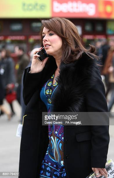 Claire Sweeney talks on her mobile phone before the first race during day three of the Cheltenham Festival at Cheltenham Racecourse