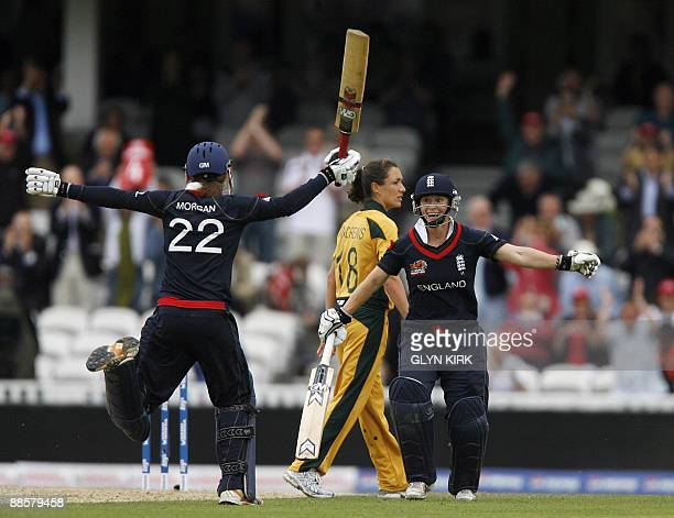 Claire Taylor of England celebrates with teammate Beth Morgan after beating Australia by 2 runs during the Womens semi final stage of the ICC...