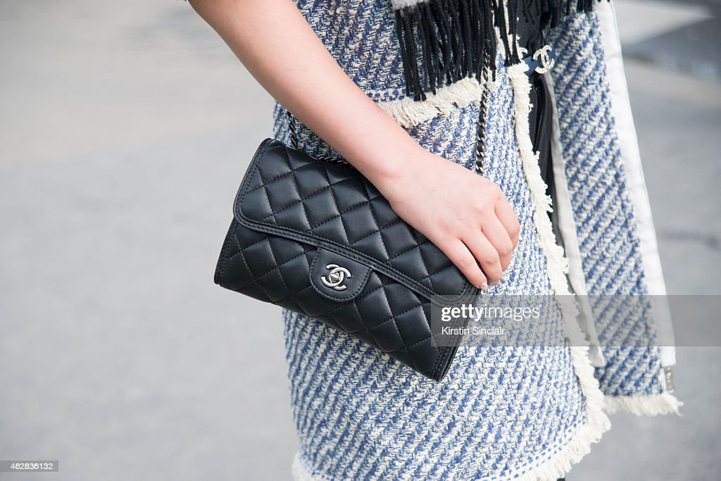 Claire Zhai wears coat and scarf by Chanel day 3 of Paris Haute Couture Fashion Week Spring/Summer 2015 on January 27 2015 in Paris France
