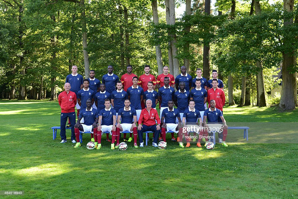 France's national football team members pose for the officiel picture 2014-2015 (from L-R and Up-Down) defender Jeremy Mathieu, forward Alexandre Lacazette, midfielder Moussa Sissoko, goalkeeper Steve Mandanda, goalkeeper Hugo Lloris, goalkeeper Stephane Ruffier, defender Eliaquim Mangala, defender Lucas Digne and midfielder Remy Cabella, (center-from L) assistant coach Guy Stephan, forward Loic Remy, midfielder Rio Mavuba, defender Mathieu Debuchy, defender Raphael Varane, forward Antoine Griezmann, midfielder Paul Pogba, defender Bakary Sagna, midfielder Morgan Schneiderlin and goalkeeper coach Franck Raviot, (down-from L) France's defender Mamadou Sakho, midfielder Yohan Cabaye, forward Karim Benzema, head coach Didier Deschamps, midfielder Blaise Matuidi, midfielder Mathieu Valbuena and defender Patrice Evra on September 2, 2014 in Clairefontaine- en Yvelines, France.
