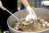 Clam bake being served from a pot