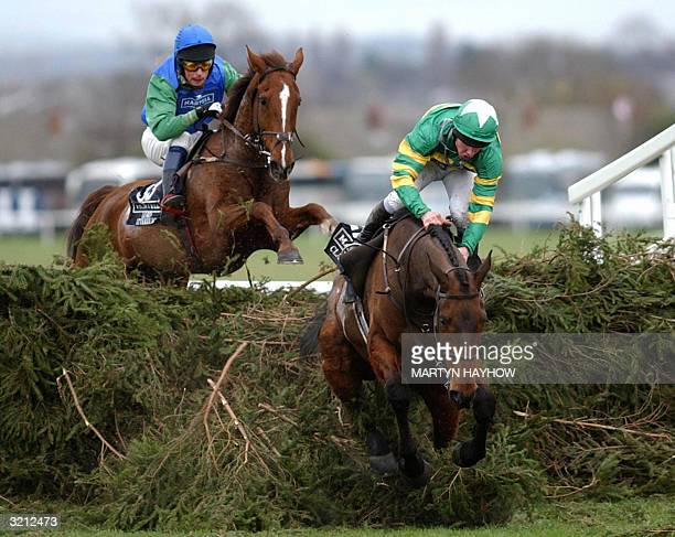 Clan Royal nearly unseats his rider Liam Cooper ahead of Lord Atterbury ridden by Mark Bradburne at the last fence in the 2004 Martell Cognac Grand...