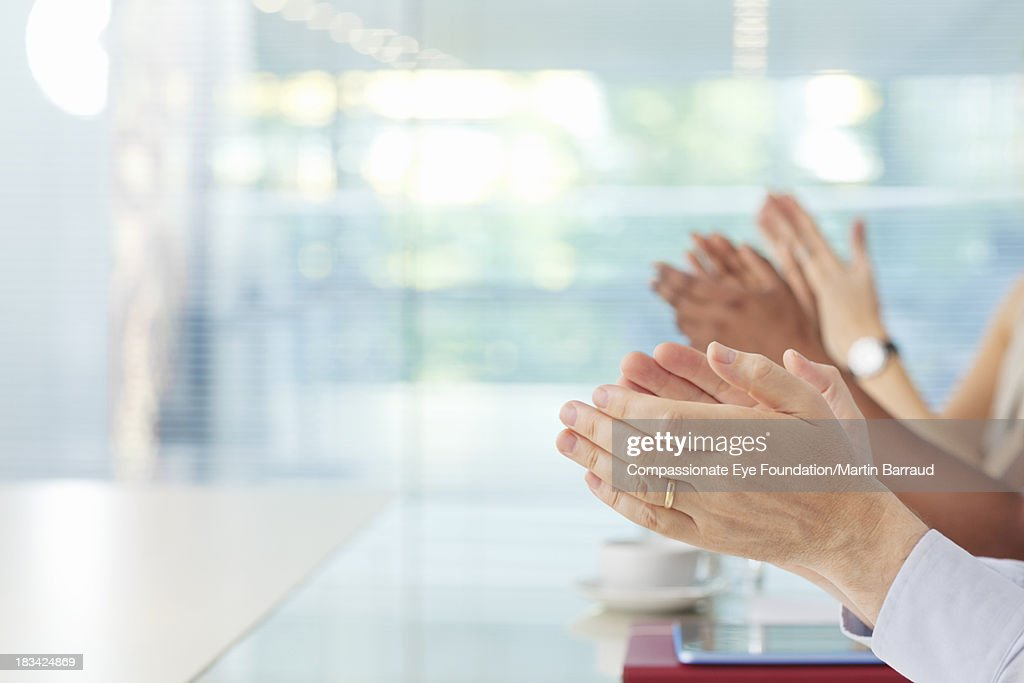 Clapping business people in office, hands only : Stock Photo