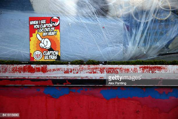 Clapton Ultras stickers are pictured around the stadium during The Emirates FA Cup Qualifying First Round match between Clapton and Needham Market at...