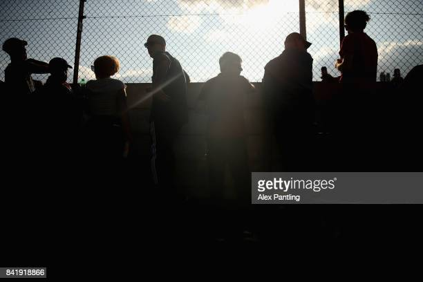 Clapton Ultras watch on from outside the stadium as they protest during The Emirates FA Cup Qualifying First Round match between Clapton and Needham...