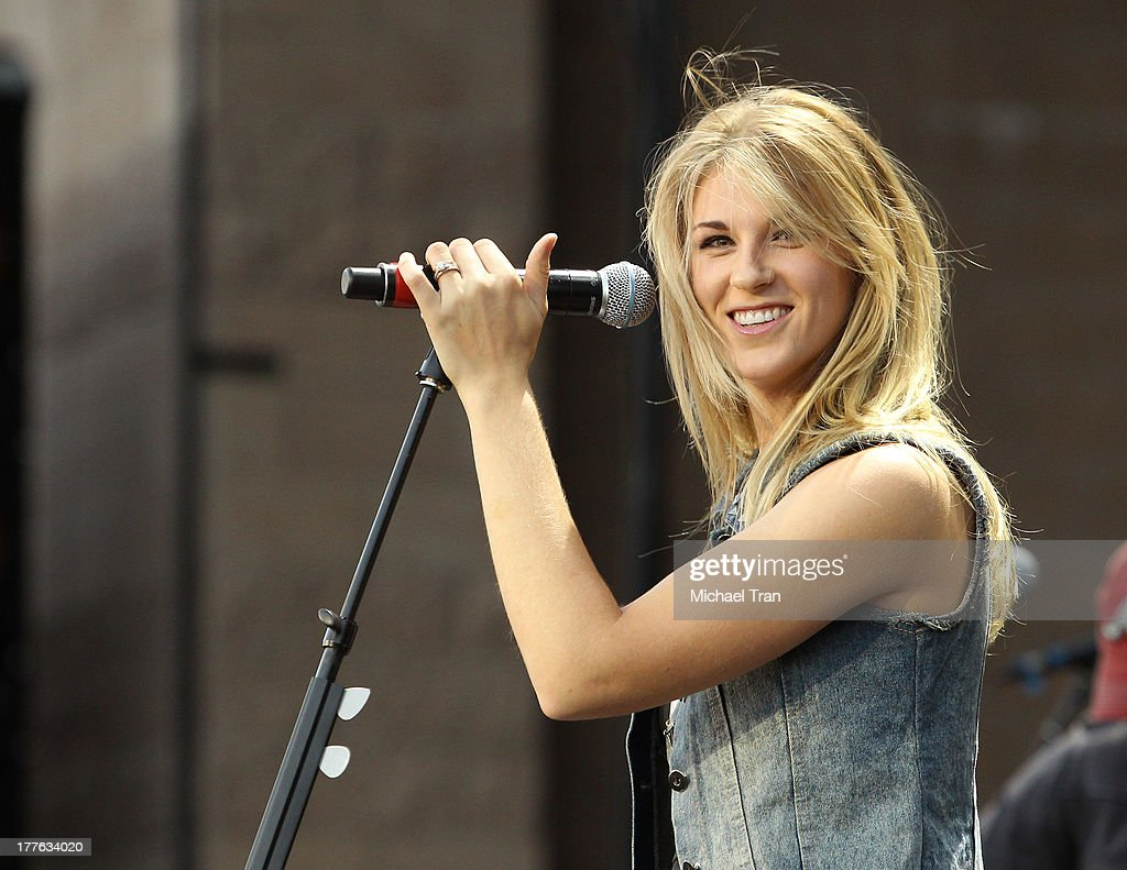 Clara Henningsen of The Henningsens performs onstage during the 'Beat This Summer Tour' held at San Manuel Amphitheater on August 24, 2013 in San Bernardino, California.