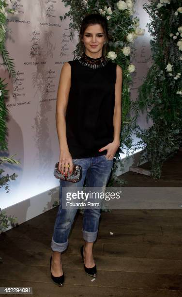 Clara Lago attends 'La Cristalizacion De La Rosa Blanca' party photocall at Adolfo Dominguez store on November 27 2013 in Madrid Spain