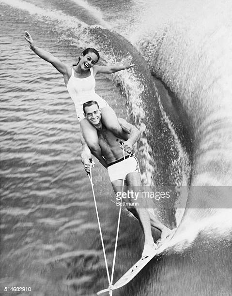 Clara Marquis rides on the shoulders of fellow water skier Jim Boyd in a show at Cypress Gardens Florida