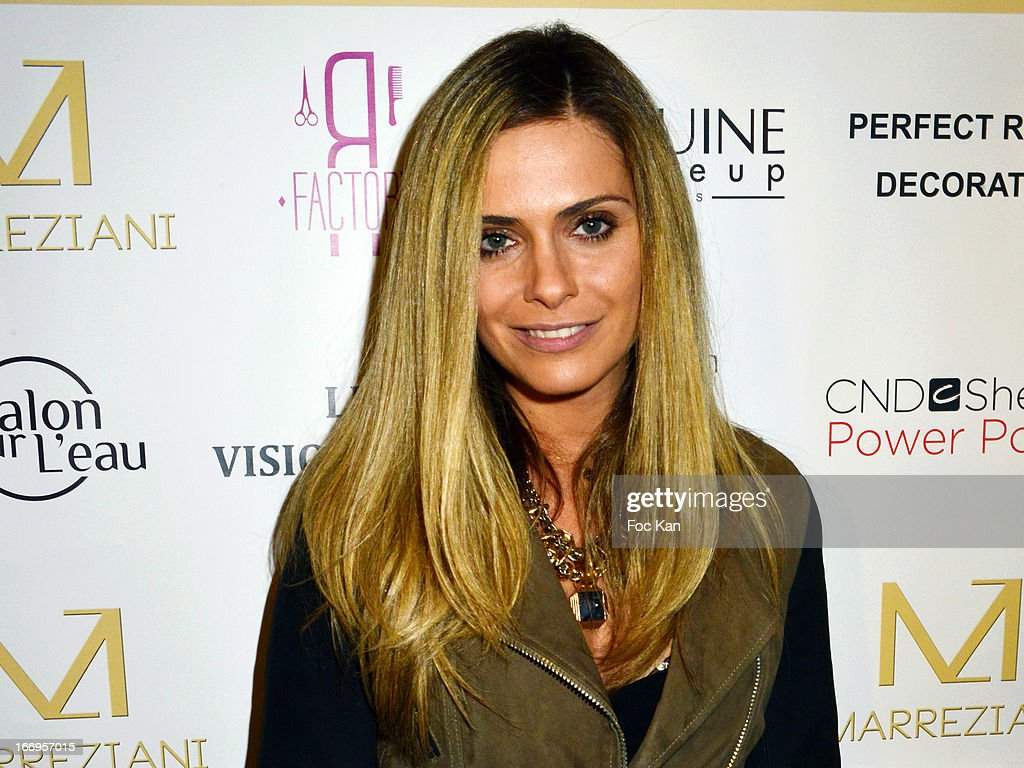 <a gi-track='captionPersonalityLinkClicked' href=/galleries/search?phrase=Clara+Morgane&family=editorial&specificpeople=4115034 ng-click='$event.stopPropagation()'>Clara Morgane</a> attends 'Le Salon Sur L'Eau Marrezziani And Le Cap Swimming Suits' Show Cocktail At Quai Marcel Dassault on April 18, 2013 in Suresnes, France.