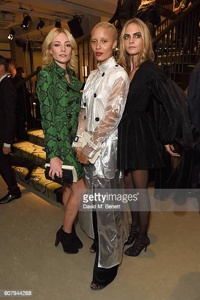 Clara Paget Adwoa Aboah and Cara Delevingne wearing Burberry at the Burberry September 2016 show during London Fashion Week SS17 at Makers House on...