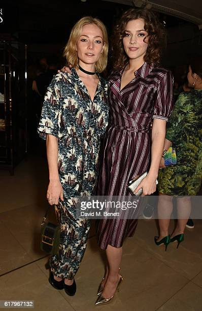 Clara Paget and Amber Anderson attend the Burberry BAFTA Breakthrough Brits at Burberry on October 25 2016 in London England