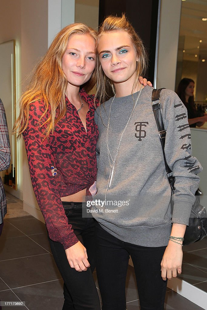 Clara Paget and <a gi-track='captionPersonalityLinkClicked' href=/galleries/search?phrase=Cara+Delevingne&family=editorial&specificpeople=5488432 ng-click='$event.stopPropagation()'>Cara Delevingne</a> attend the Trilogy flagship store launch party on August 21, 2013 in London, United Kingdom.