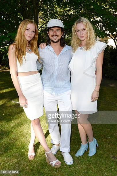 Clara Paget Luke Arnold and Hannah New attend the Club Monaco Garden Party hosted by Quentin Jones Clara Paget and Annie Morris in Eaton Square on...