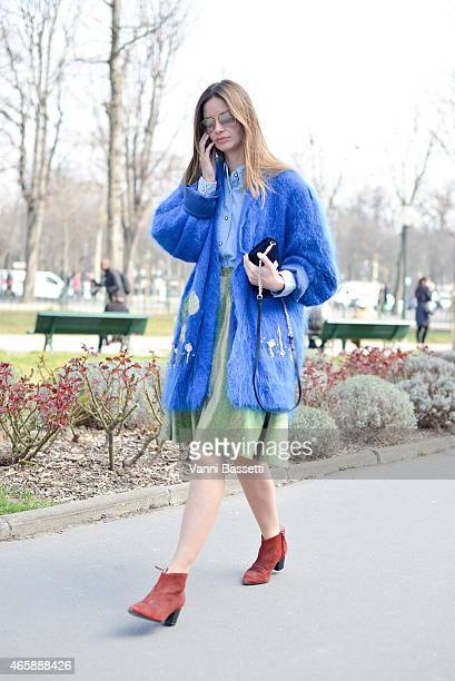 Clara Racz arrives at the Moncler Gamme Rouge show wearing a vintage outfit on Day 9 of Paris Fashion Week Womenswear FW15 on March 11 2015 in Paris...