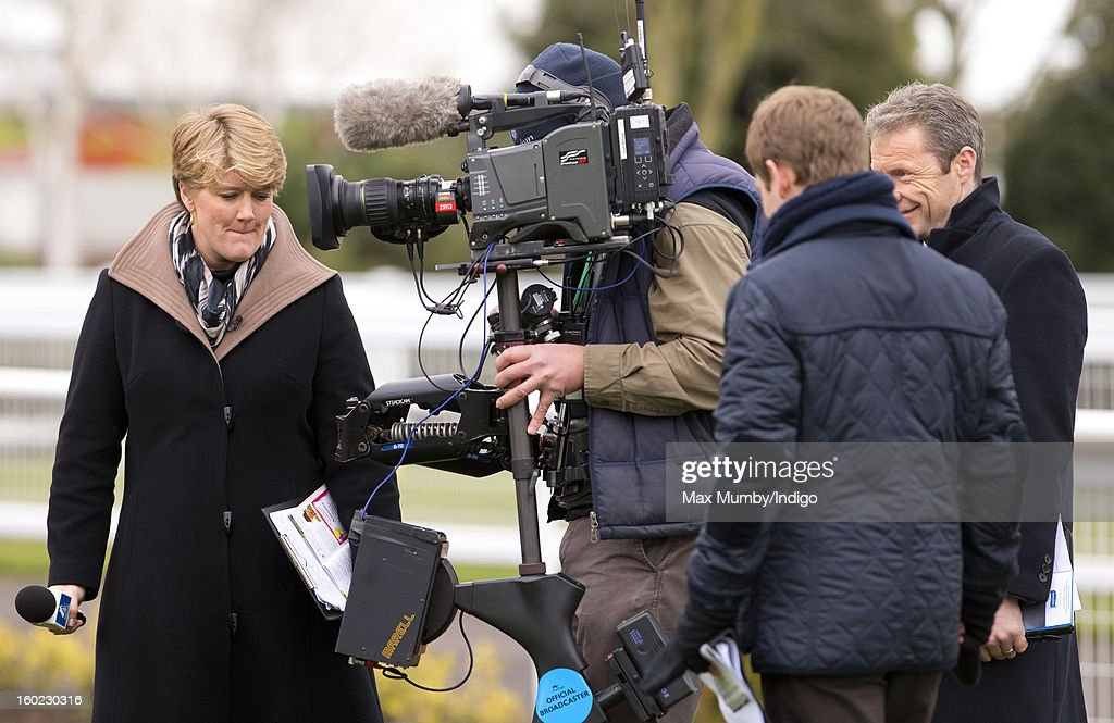Clare Balding prepares to interview racehorse trainer Nicky Henderson during her first live racing broadcast for Channel 4 Racing at the Festival Trials Day at Cheltenham Racecourse on January 26, 2013 in Cheltenham, England. Clare Balding heads up the new team of presenters for Channel 4 Racing.