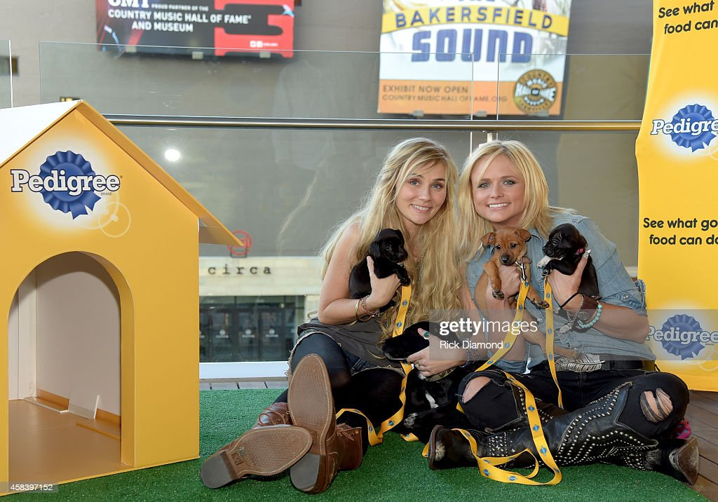Clare Bowen and Miranda Lambert share their love for shelter dogs at the Pedigree Adoption Suite at Music City Center on November 3 2014 in Nashville...