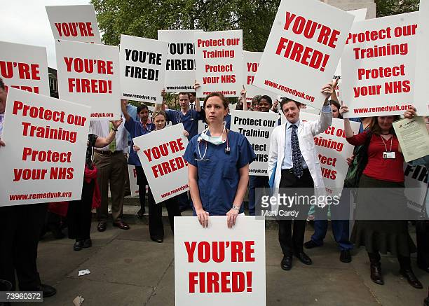 Clare Cooke stands among protest placards during the junior doctors rally in Westminster on April 24 2007 in London England The protest organised by...