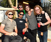 Clare Dunn's Band and Tour Manager Joey Supak backstage during Kicker Country Stampede Day 2 on June 26 2015 at Tuttle Creek State Park in Manhattan...