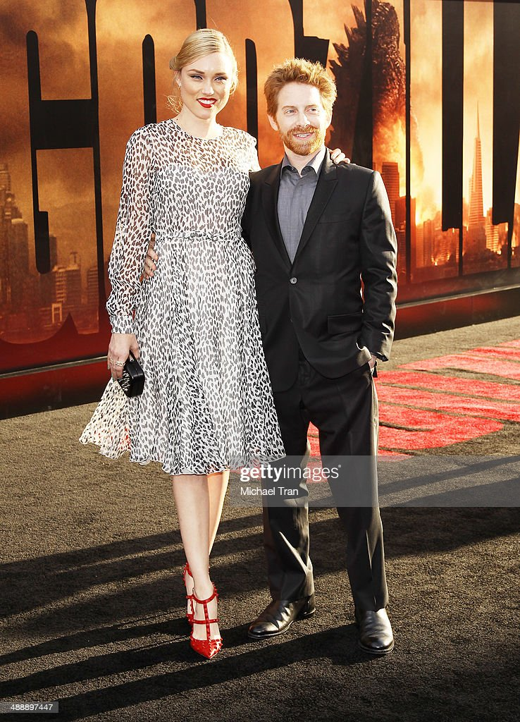 Clare Grant (L) and Seth Green arrive at the Los Angeles premiere of 'Godzilla' held at Dolby Theatre on May 8, 2014 in Hollywood, California.