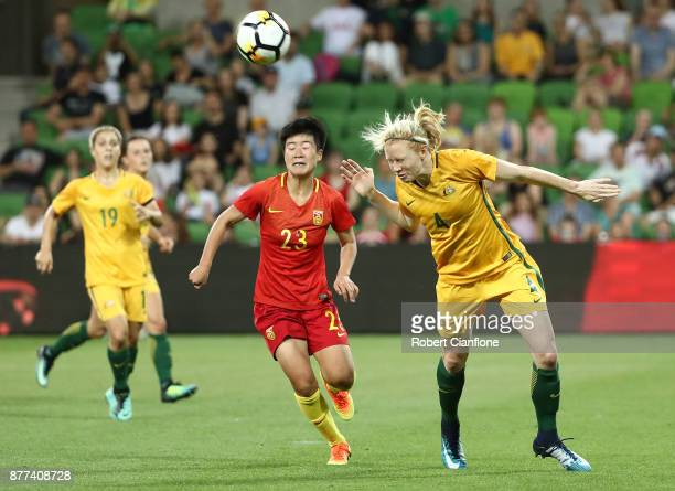 Clare Polkinghorne of the Matildas heads the ball away from Ren Guixin of China PR during the Women's International match between the Australian...