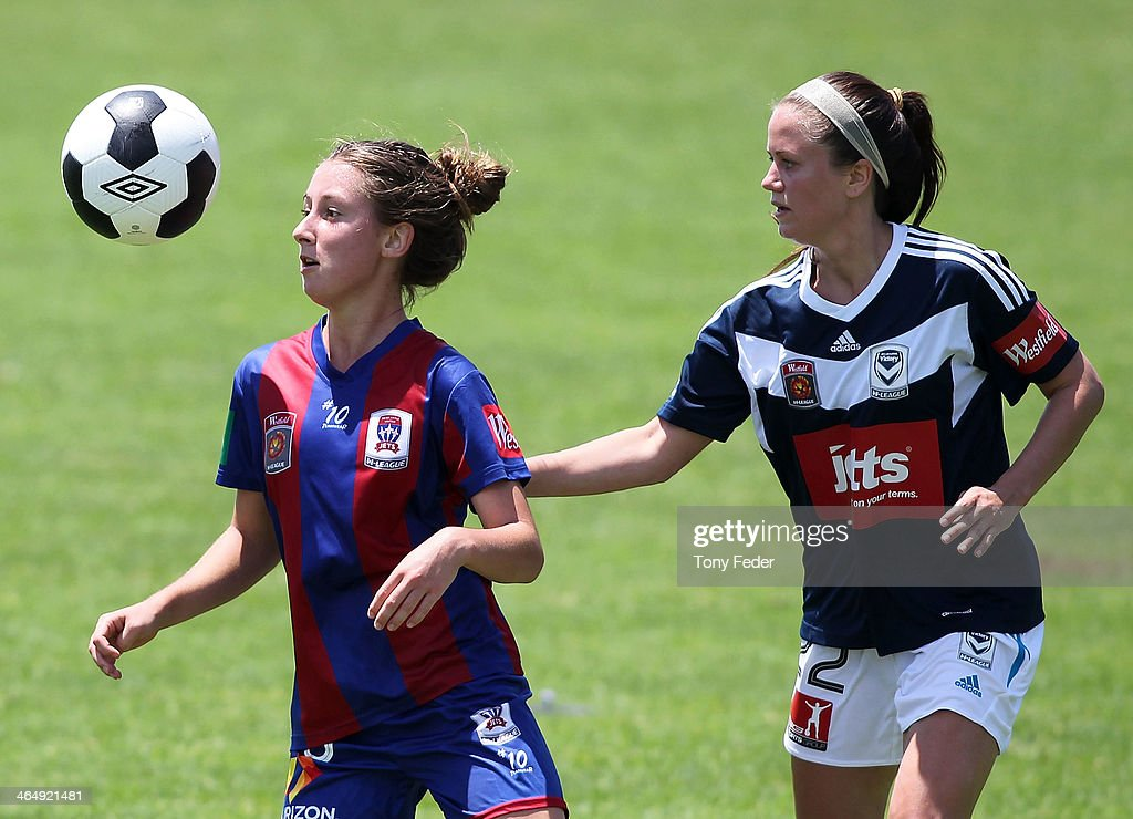 Clare Wheeler of the Jets contests header against Lauren Barnes of the Victory during the round 10 W-League match between the Newcastle Jets and Melbourne Victory at Adamstown Oval on January 25, 2014 in Newcastle, Australia.
