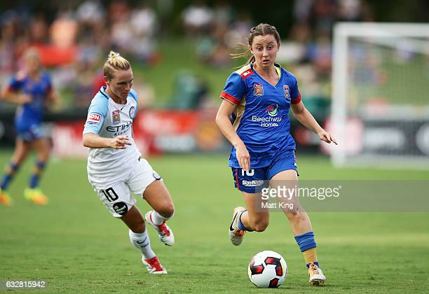 Clare Wheeler of the Jets is challenged by Jessica Fishlock of Melbourne City during the round 14 WLeague match between the Newcastle Jets and...