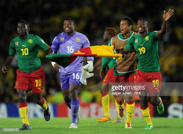 Clarence Bitang Jean Efala Yannick Makota and Christ Mbondi of Cameroon celebrate at the end of the FIFA U20 World Cup Colombia 2011 group B match...